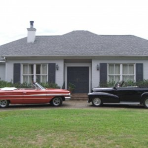 This picture was taken at Cruisin the coast 2009. We rented this house for the week and cruised the Mississippi coast. The cars are 64 Galaxie conv. &