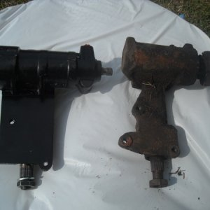 Comparison of 2 steering boxes Notice part where rag joint connects is longer.
